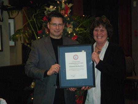 BCAS Unit Chief Elizabeth Richardson receives Commendation award from BCAS Executive Director for Vancouver Island Region, Shawn Carby