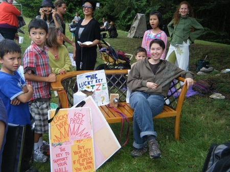 Lucky Key Prize, a beautiful outdoor bench donated by Quadra Builders, was won by Maggie Armitage who  brings all of Cortes our mail.