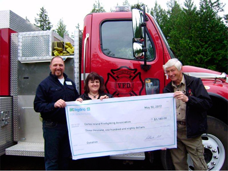 Above: Scott McLean, Field Manager, presents the cheque to Bertha Jeffery, Treasurer for CIFA, and Ben Fulton, President of CIFA, on behalf of BC Hydro