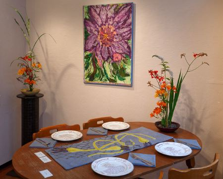 table runner and napkins, Jan Boas; ceramic dishes, Ester Strijbos; painting, Eileen O'Howe