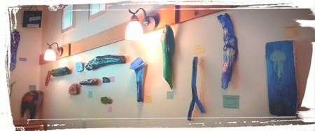 A wall of driftwood art by AIL kids