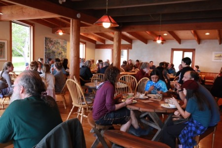 Community Supper inside the Hollyhock Lodge